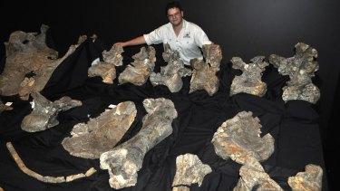 Stephen Poropat with the fossilised remains of Savannasaurus elliottorum - found in Queensland.