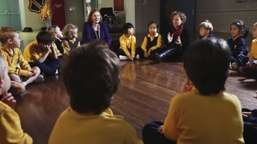 Starting young: Ethics teachers Jane Morris and Carol Connolly talk with kindergarten students at Haberfield Public School.