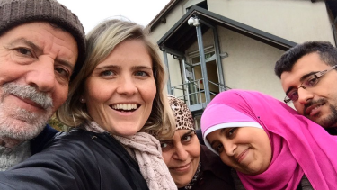 ABC journalist Sophie McNeill with Syrian refugee Nazieh Husein and his family, reuinted and safe in Germany.
