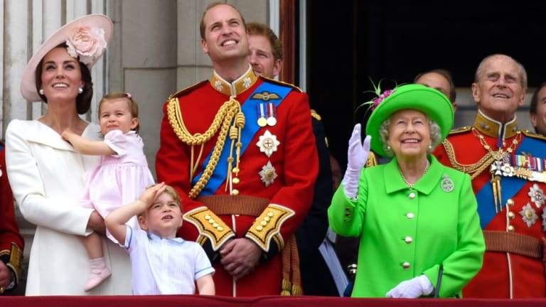 Queen Elizabeth II (in green) is surrounded by family during her 90th birthday celebrations.