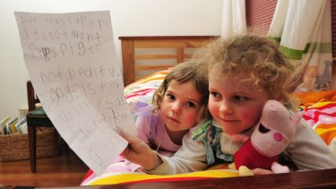 Peppa Pig fan Tess Coventry, 5, with the letter she wrote calling for the popular children's TV show to stay on the ABC for her sister India, 2.
