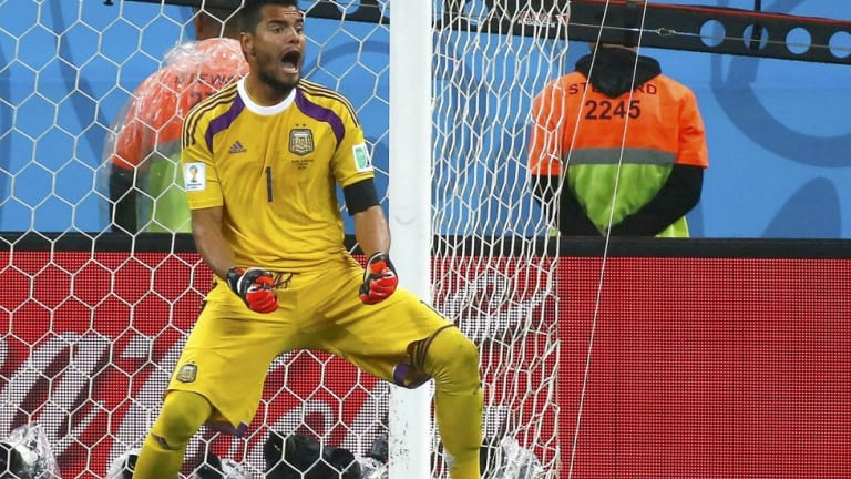 Sergio Romero saved two penalties in the shootout.