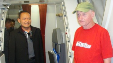 Peter Walbran, right, arrives in Indonesia in 2011 to face child rape charges.