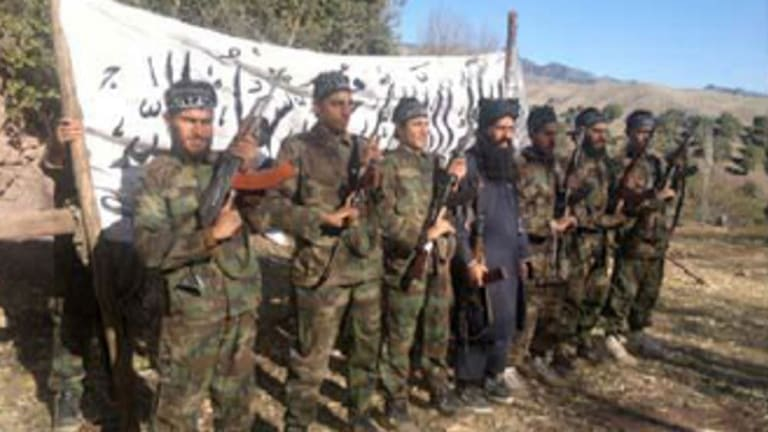 A photo released by the Pakistani Taliban purportedly shows the militants who stormed the school.