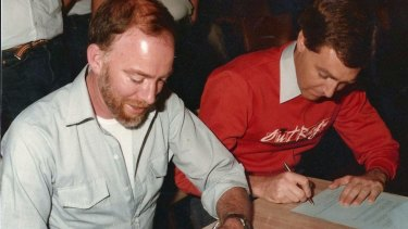Lex Watson (left) and Robert French signing statutory declarations in 1983.
