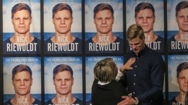 Nick Riewoldt is congratulated by his mother at his book launch.