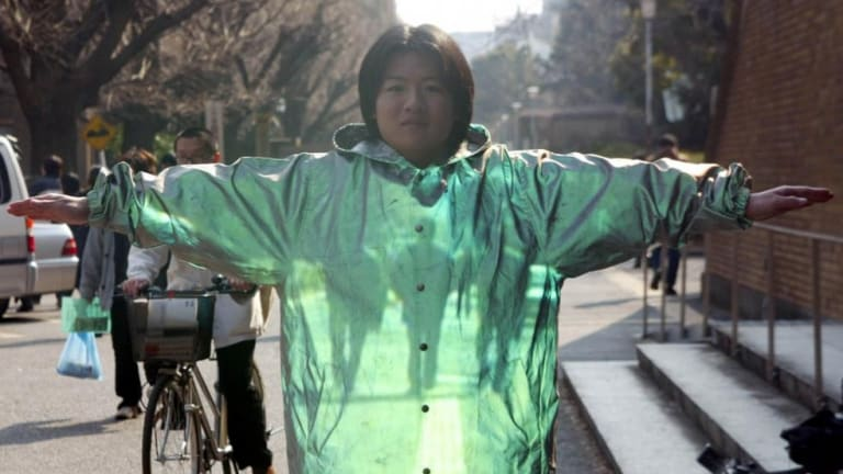A demonstration of optical camouflage technology at Tokyo University, conducted by Faculty of Engineering professor Susumu Tachi, in Tokyo in this Febuary 5, 2003 file photo.