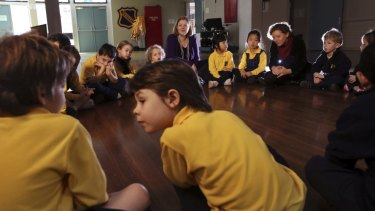 Ethics teachers Jane Morris and Carol Connolly talk with kindergarten students at Haberfield Public School.
