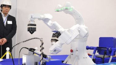 Epson's new dual-arm robot. The company hopes to have it working production and assembly lines within two years.