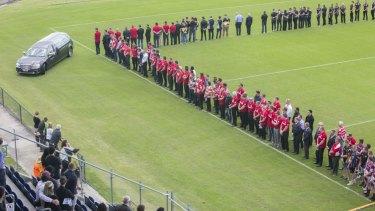 Teammates gathered around the field's edges as Ackermann was taken on a final lap of honour around the stadium.