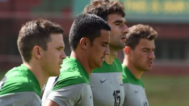 Socceroos Matt McKay, Tim Cahill, Mile Jedinak and James Troisi jog during training in Vitoria.