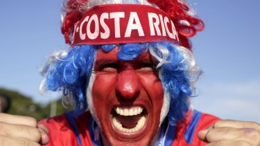 Plenty to cheer about ... A supporter celebrates Costa Rica's classification at the top of Group D following the draw against England.