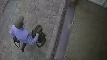 The man believed to be responsible for an attack on a Brussels Jewish museum is captured on CCTV leaving the museum on May 24, 2014..
