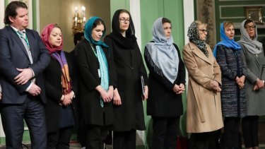 """Sweden's """"first feminist government"""" don hijabs in Iran."""