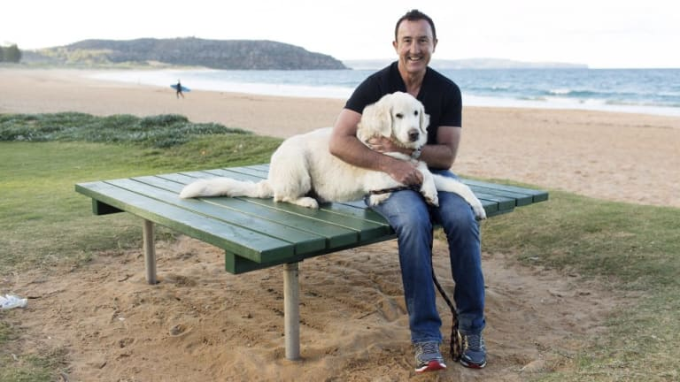 Rising costs: Bruce Purser with his pet dog Nalu.