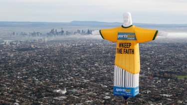 Hot air: the balloon in shape of Rio's Christ the Redeemer statue floats over Melbourne.