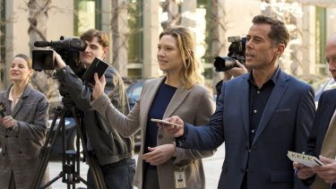 Anna Torv as Harriet Dunkley, centre, with Marcus Graham as Andrew Griffiths, right, in <i>Secret City</i>.