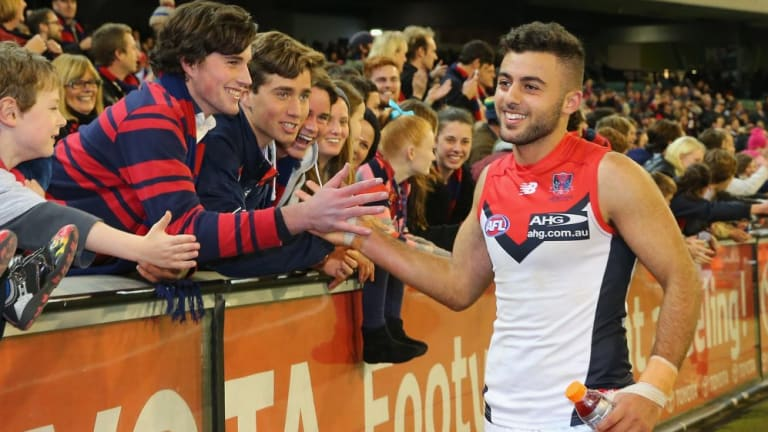 Christian Salem celebrates with Demons supporters after the game.