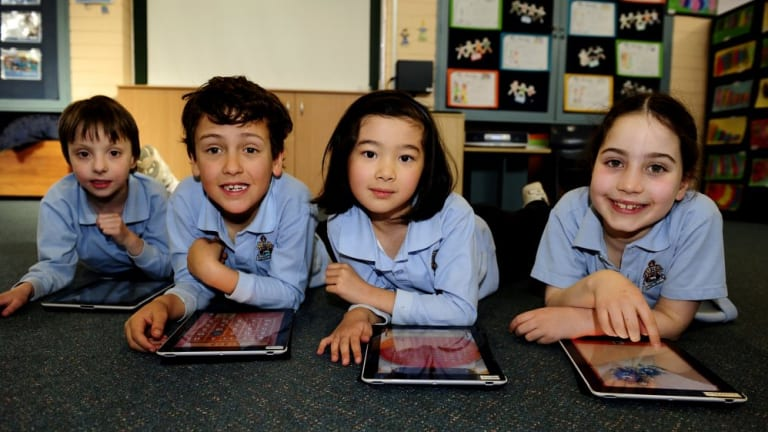 Northside Grammar School pupils, from left, Angus Hudson, Dashiell Brown-Rees, Bella Mun and Holly Irvine use iPads in class in this 2012 file photo.