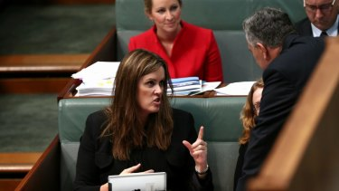 Treasurer Joe Hockey in discussion with Peta Credlin, chief of staff to the Prime Minister.
