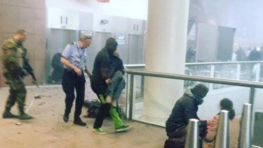 An image of Alphonse Youla carrying a person from the blast scene has been widely shared.