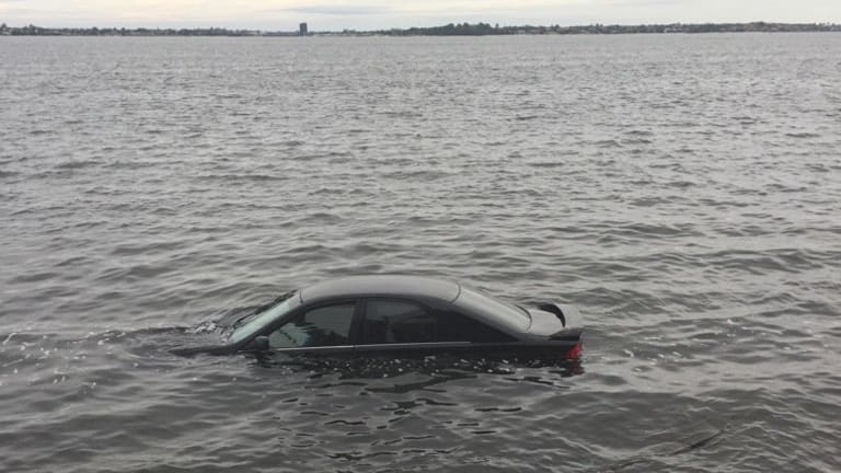The car in the Swan River after the incident.