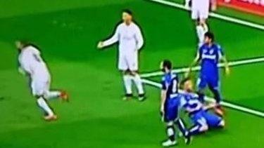 Ronaldo shrugs his shoulders as Karim Benzema celebrates.