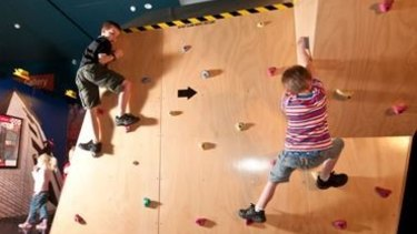 Rock wall climbing at the Rescue exhibition, Queensland Museum.
