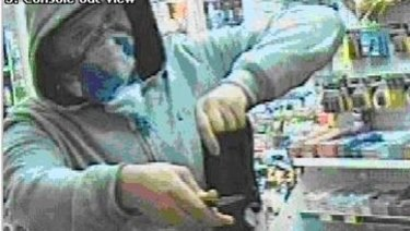"""A robbery by a man armed with a knife at a petrol station in Newcastle, NSW, in March 2012. The robber took $500 and """"a quantity of cigarettes""""."""