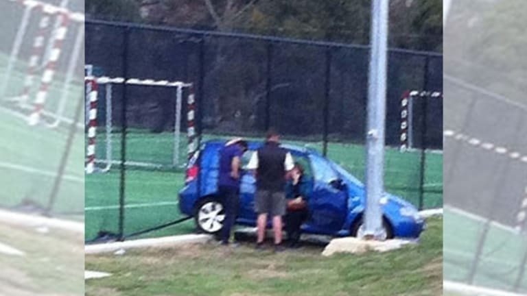 The woman in her car at Blackburn High School.