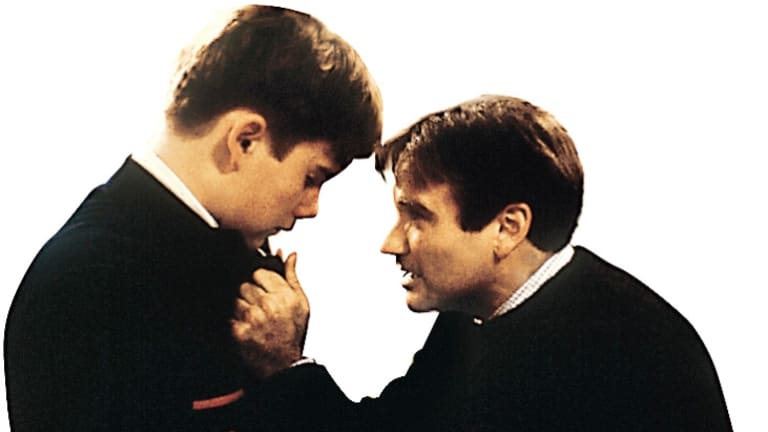 Robin Williams, right, as the inspirational English teacher John Keating in the 1989 film <i>Dead Poets Society</i>.