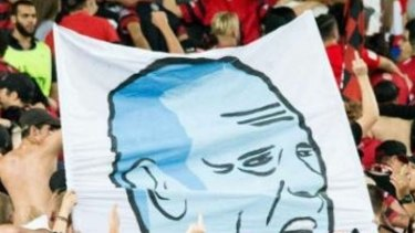 A section of the tifo featuring a likeness of Sydney FC coach Graham Arnold performing a sex act.