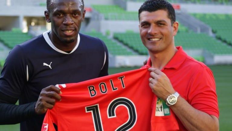 Football fanatic: Usain Bolt with John Aloisi.