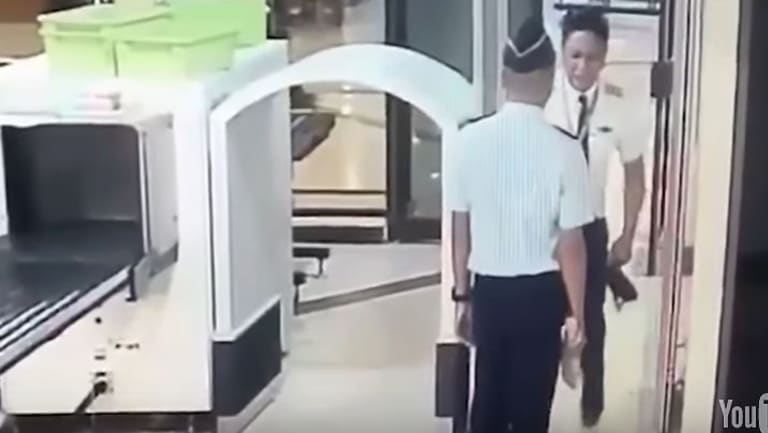A video captured a Citilink pilot staggering through security at Surabaya airport.
