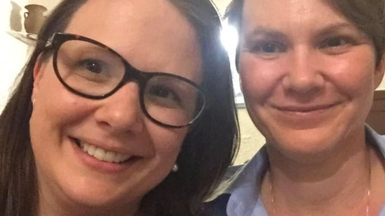 """Kristina Antoniades (left), with her partner Merrin Hicks, has taken to Facebook to accuse Qantas of """"blatant homophobia""""."""