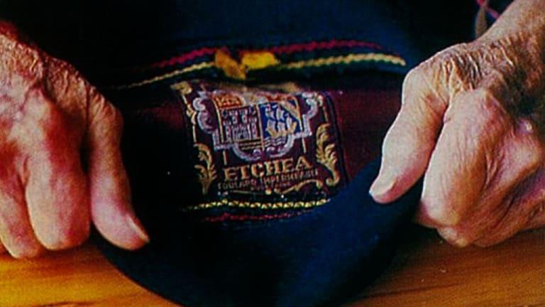 Rees's characteristic beret.