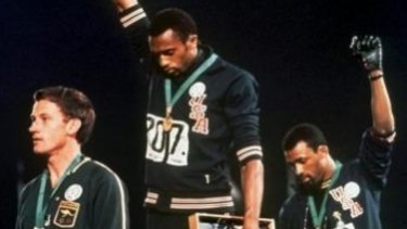 "Australia's Peter Norman (left) joins American athletes Tommie Smith and John Carlos on the podium during the famous ""Black Power"" demonstration."