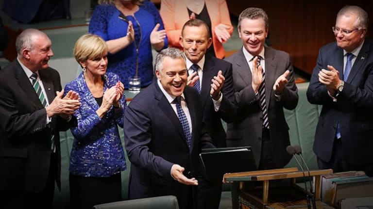 Treasurer Joe Hockey and Prime Minister Tony Abbott arrive to hand down the Budget in the House of Representatives at Parliament House on Tuesday 12 May 2015.