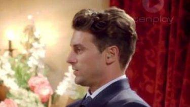 Matty J seen wearing an earpiece.