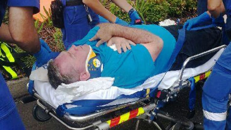 Paramedics treat Ryde mayor Bill Pickering after he was punched at Putney Public School.
