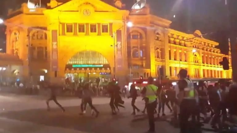 Apex gang rioters in Melbourne CBD, outside Flinders Street Station.