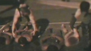 Detainees were tear-gassed and taken out of their cells and hosed off on the ground.