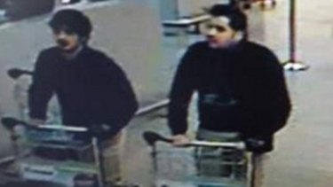 Two of the suspected bombers captured on CCTV footage minutes before the fatal blasts at the airport. Police are searching for the man on the right.