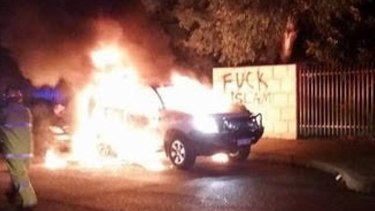 A 4WD engulfed in flames outside the Thornlie Mosque.