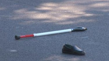 A walking stick and shoe at the scene of the crash.