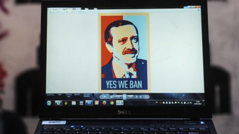 A computer screen shows a portrait of Turkish Prime Minister Recep Tayyip Erdogan.