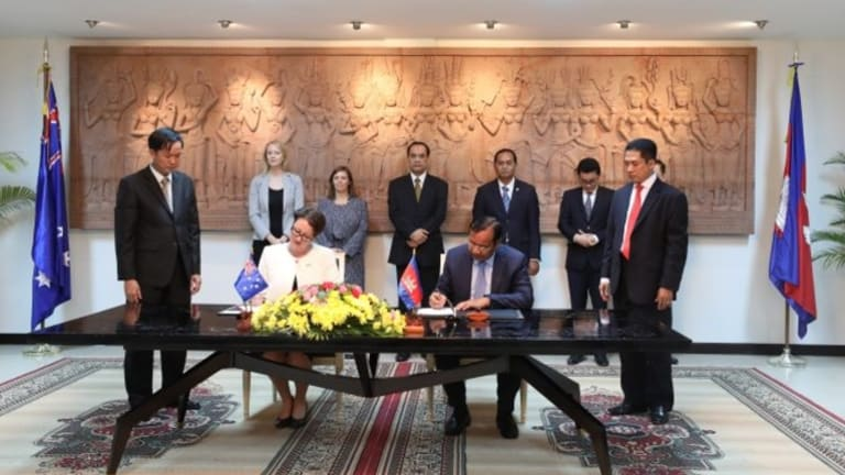 Angela Corcoran signs an MoU with Cambodian's Minister of Foreign Affairs Prak Sokhonn on October 18.