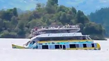 The El Almirante ferry sinks below the surface of the Guatape reservoir.