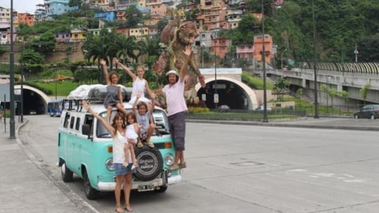 Hola Ecuador! ... The Walker family stretch their legs during the great drive north.