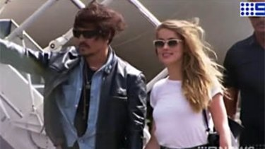 Johnny Depp and Amber Heard arrive at Brisbane Airport last year.